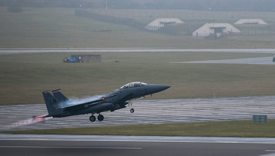 A 494th Fighter Squadron F-15E Strike Eagle takes off from Royal Air Force Lakenheath, England, Feb. 5, 2015. The pilots of the 494th Fighter Squadron, known as the Panthers, participated in a three-day exercise to evaluate their response time to simulated alerts. The Panthers focused on maintaining joint readiness while building interoperable capabilities. (U.S Air Force photo by Airman 1st Class Dawn M. Weber/Released)