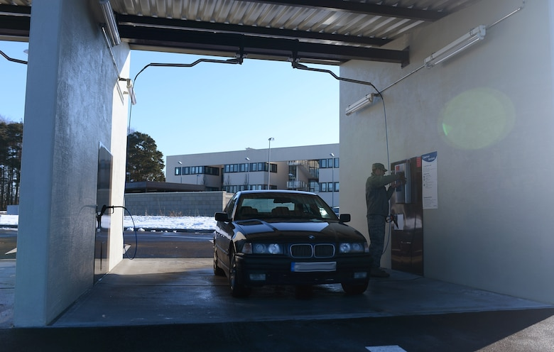 A Spangdahlem Airman uses the newly opened self-service carwash on Spangdahlem Air Base, Germany, Feb. 4, 2015. The carwash officially opened Feb. 2, 2015 and costs nearly one million dollars to build. (U.S. Air Force photo illustration by Airman 1st Class Luke Kitterman/Released)