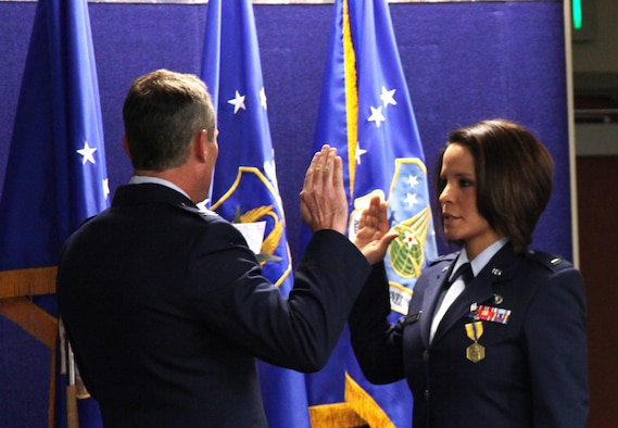 1st Lt. Iris Morales, Medical Service Corps officer and former Air Reserve Personnel Center contact center noncommissioned officer, is administered the Oath of Office by Col. Pat Hayes, ARPC Total Force Service Center director, during a commissioning ceremony held Jan. 30, 2015, on Buckley Air Force Base, Colo. (U.S. Air Force photo/Tech. Sgt. Rob Hazelett)