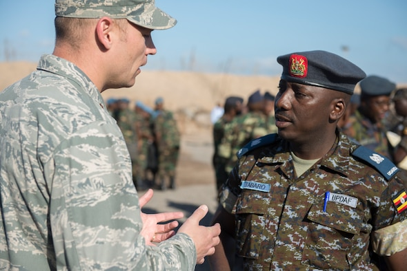DJIBOUTI AIR BASE, Djibouti -- U.S. Air Force Maj. Dirk Casson speaks with Ugandan Air Force Maj. Tabaro Kinconco during African Partnership Flight-Djibouti at Djibouti Air Base, Djibouti, Feb. 7, 2015. The goal of the event is to discuss possible best practices of the neighboring nations and strengthen relationships among Airmen to improve regional security. (U.S. Air Force photo/Tech. Sgt. Benjamin Wilson)