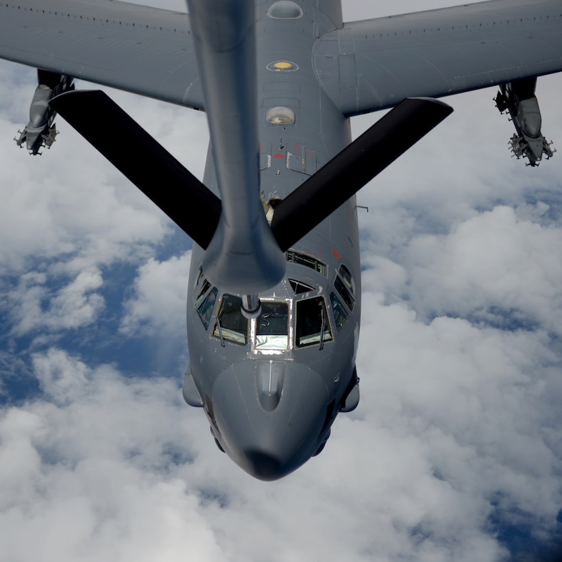U.S. Air Force flight crew members from the 157th Air Refueling Wing, N.H., prepare a KC-135 Stratotanker from the 506th Expeditionary Air Refueling Squadron to participate in an air refueling training mission Jan. 19, 2015 over the Pacific Ocean near Andersen Air Force Base, Guam. The 157 ARW crew executed the training mission along with a B-52 Stratofortress operated by crew members from the 96th Expeditionary Bomb Squadron, which is deployed to Guam from Barksdale Air Force Base, L.A. (U.S. Air National Guard photo by Senior Airman Kayla McWalter/RELEASED)