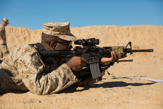 Lance Cpl. Darius M. Phillips sights in an M16A4 service rifle before firing table three alpha (rifle course) Jan. 23 as part of Integrated Training Exercise 2-15at Marine Air Ground Combat Center Twentynine Palms. Marines shot both table three alpha and table three bravo, and participated in chemical, biological, radiological and nuclear training by firing after going through a gas chamber in protective gear. Phillips, a Warner Robins, Georgia, native, is an administrations clerk with 3rd Marine Division, III Marine Expeditionary Force attached to Headquarters Company, 4th Marine Regiment, 3rd Marine Division, III MEF.