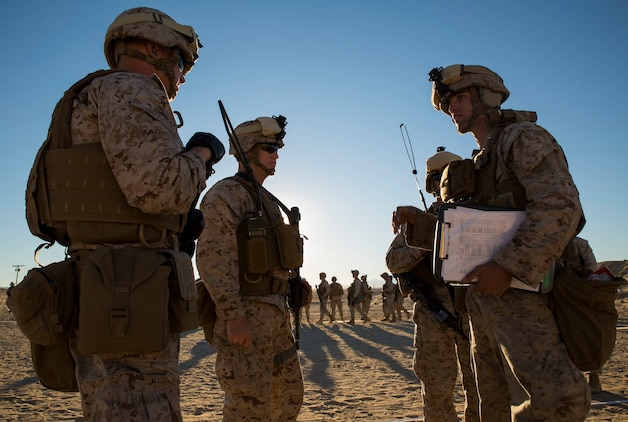 "Lance Cpl. Bradley W. Walsh (right) discusses the table three course of fire and safety precautions Jan. 23 with the range safety officers and the officer in charge at Marine Air Ground Combat Center Twentynine Palms as part of Integrated Training Exercise 2-15. ""Safety is paramount in the Marine Corps,"" said Capt. Steven E, Christopher (second from left). Christopher, a Derry, New Hampshire, native is the company commander for Headquarters Company, 4th Marine Regiment, 3rd Marine Division, III Marine Expeditionary Force. Walsh, a Granville, Ohio, native, is a rifleman also with 4th Marines."