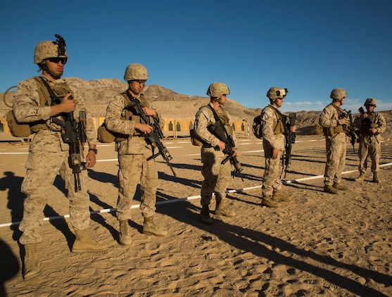 Marines face up-range as a safety precaution, prior to firing table three alpha (rifle course) Jan. 23 at Marine Air Ground Combat Center Twentynine Palms as part of Integrated Training Exercise 2-15. Safety is paramount, according to Capt. Steven E. Christopher, a Derry, New Hampshire, native and the company commander for Headquarters Company, 4th Marine Regiment, 3rd Marine Division, III Marine Expeditionary Force. The Marines are also with 4th Marines.