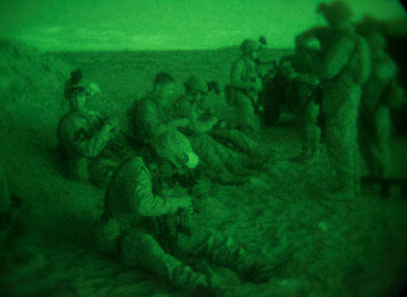 Marines load their magazines Jan. 23 before firing table three bravo (rifle course), the night equivalent of table three alpha, at Marine Air Ground Combat Center Twentynine Palms, as part of Integrated Training Exercise 2-15. Table three includes shooting from close distances as well as shooting while moving to incorporate combat oriented marksmanship. The Marines are with Headquarters Company, 4th Marine Regiment, 3rd Marine Division, III Marine Expeditionary Force.