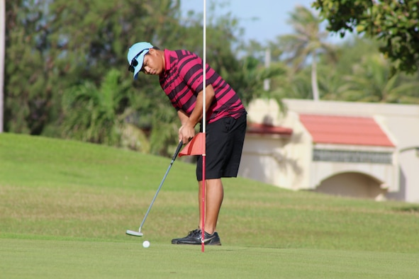 A Team Andersen golfer focuses on his put Jan. 31, 2015, during a tournament on Andersen Air Force Base, Guam. About 60 golfers participated in a tournament and enjoyed the upgraded amenities of the new golf pro shop and its location. (U.S. Air Force photo by 1st Lt. Jessica Clark/Released)