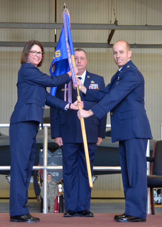 Lt. Col. Matthew Calhoun accepts the 131st Aircraft Maintenance Squadron guidon from Col. Kimbra Sterr, 131st Maintenance Group commander, during Calhoun's Assumption of Command ceremony at Whiteman Air Force Base, Mo., Feb. 7, 2015.