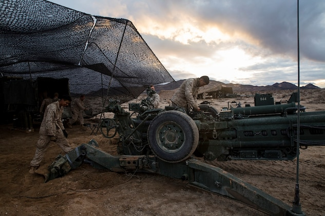 Marines with Alpha Battery perform weapon maintenance on a M777A2 lightweight 155 mm howitzer Jan. 30 at Marine Air Ground Combat Center Twentynine Palms during Integrated Training Exercise 2-15. Cannoneers clean their weapons multiple times a day to keep them functioning correctly. The Marines are with Alpha Battery, 1st Battalion, 12th Marine Regiment, currently assigned to 3rd Battalion, 12th Marines, 3rd Marine Division, III Marine Expeditionary Force for ITX 2-15 as part of the ground combat element of Special Purpose Marine Air-Ground Task Force 4.