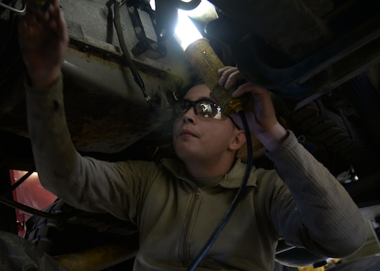 Senior Airman Lloyd Carlyle, 27th Special Operations Logistics Readiness Squadron fire truck mechanic, works on an out-of-service M35 fire truck Feb. 5, 2015 at Cannon Air Force Base, N.M. The M35 is typically used at Melrose Air Force Range, N.M., to combat brush fires. (U.S. Air Force photo/Staff Sgt. Alexxis Mercer)