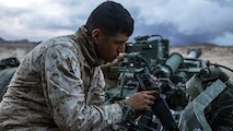Lance Cpl. Christian J. Hernandez cleans the breach of a M777A2 lightweight 155 mm howitzer Jan. 30 at Marine Air Ground Combat Center Twentynine Palms during Integrated Training Exercise 2-15 to keep the weapon firing properly. The howitzer is capable of firing high explosive, illuminating, smoke and satellite guided rounds. Hernandez, a Buford, Georgia, native, is a cannoneer with Alpha Battery, 1st Battalion, 12th Marine Regiment, currently assigned to 3rd Battalion, 12th Marines, 3rd Marine Division, III Marine Expeditionary Force for ITX 2-15 as part of the ground combat element of Special Purpose Marine Air-Ground Task Force 4. (U.S. Marine Corps photo by Lance Cpl. William Hester/ Released)