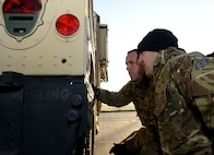 Royal Air Force Senior Aircraftman Oliver Parsons, left, and Flt. Lt. Craig Rawlins, Joint Air Delivery trials and evaluations unit members, inspect a Humvee during training Jan. 20, 2015, on RAF Mildenhall, England. The RAF members worked with members of the 352nd Special Operations Support Squadron deployed aircraft ground response element to practice loading and unloading the Humvee in preparation for their upcoming joint training exercise, Emerald Warrior, held at Hurlburt Field, Fla. (U.S. Air Force photo by Senior Airman Kate Maurer/Released)