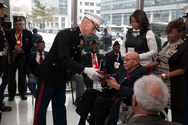 Hiram Knowles is presented a citation from the President of the United States, Barack Obama, during his award ceremony of receiving the Congressional Gold Medal. Knowles was one of over 400 Montford Point Marines to be awarded since 2012. (U.S. Marine Corps photo by Cpl. Elizabeth Thurston)