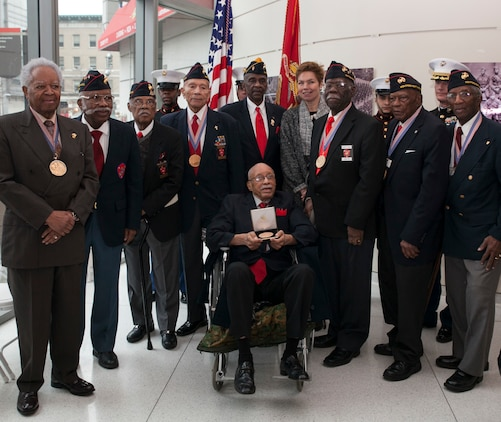 Hiram Knowles, along with fellow Montford Point Marines and supporters, pose for a photo at the conclusion of the ceremony for Knowles receiving the Congressional Gold Medal on Feb.7, 2015. Knowles was one of over 400 Montford Point Marines to be awarded since 2012. (U.S. Marine Corps photo by Cpl. Elizabeth Thurston)