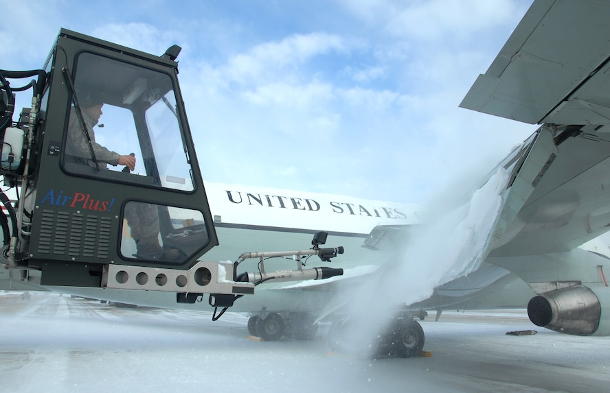 U.S. Air Force Senior Airman Kyle Kindig operates an air cannon from a deicing truck to blow snow off the wing of an OC-135 Open Skies aircraft Feb. 3 at Offutt Air Force Base Neb. Additional maintenance time is typically needed during winter operations to heat the aircraft and to remove snow and ice. Kindig is a guidance and control maintenance technician assigned to the 83rd Aircraft Maintenance Unit, 55 Aircraft Maintenance Squadron. (U.S. Air Force photo by Delanie Stafford/Released)