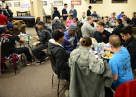 Airmen enjoy a meal at the Icebox in building 2266 during an Airman's Dinner at Eielson Air Force Base, Alaska, Jan. 20, 2015. (U.S. Air Force photo by Senior Airman Ashley Nicole Taylor/Released)
