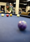 An Airman tries his hand at pool at the Icebox in building 2266 during an Airman's Dinner at Eielson Air Force Base, Alaska, Jan. 20, 2015. (U.S. Air Force photo by Senior Airman Ashley Nicole Taylor/Released)
