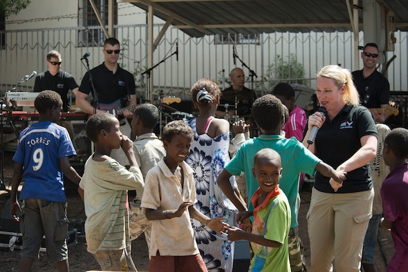 DJIBOUTI -- Staff Sgt. Jill Diem, U.S. Air Forces in Europe Band vocalist, dances with children during a performance at the Caritas Center in Djibouti Feb. 8, 2015. The USAFE Band, rock ensemble Touch n' Go, performed outreach concerts in the local community while traveling with African Partnership Flight-Djibouti. (U.S. Air Force photo/Tech. Sgt. Benjamin Wilson)