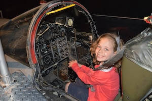 A museum visitor enjoying the F-4D Phantom II Sit-in Cockpit in the Cold War Gallery at the National Museum of the U.S. Air Force. (U.S. Air Force photo)