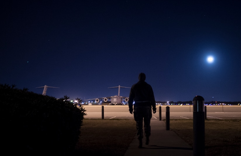 Senior Airman Kathryn Raethel, 437th Operations Support Squadron Airfield Management technician, walks from the Base Operations building out to the flight line to look for any damaged or burnt out runway lights as well as directional signs used by aircraft Feb. 9, 2015, at Joint Base Charleston, S.C. Whenever an in-flight emergency occurs, Base Operations office is notified and begins informing several different agencies to handle the delicate situation. (U.S. Air Force photo/ Senior Airman Dennis Sloan)