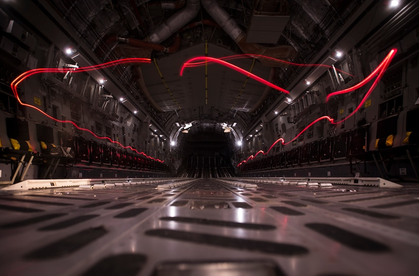 A camera using a slow shutter speed captures the light from flashlight Airmen from the 437th Operations Support Squadron use to inspect equipment inside a C-17 Globemaster III Feb. 9, 2015, at Joint Base Charleston, S.C. AFE works through the night to provide aircrew members with safe and reliable equipment, including night vision goggles, helmets, masks and even parachutes.  (U.S. Air Force photo/ Senior Airman Dennis Sloan)