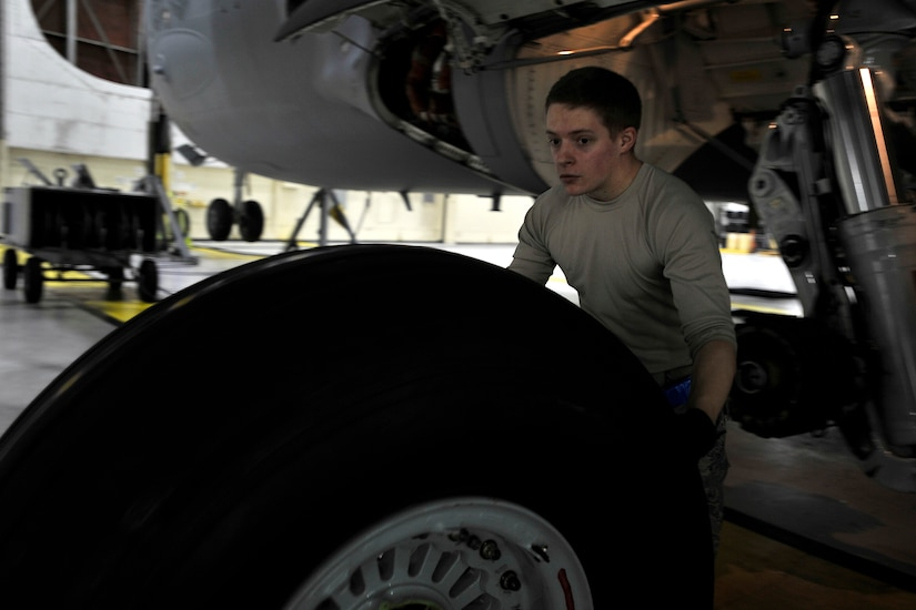 Airman 1st Class Dustin Cannady, a crew chief with the 437th Maintenance Squadron, moves tires for the C-17 Globemaster II during a home station check (HSC) at Joint Base Charleston, S.C., Feb. 9, 2015. The average HSC check is typically three, 24-hour days in which multiple sections of the flight line maintenance squadron perform in-depth inspections of the airframes, looking for damage and deficiency. Cannady and his teammates work late into the night to accomplish the mission. (U.S. Air Force photo/Tech. Sgt. Renae Pittman)