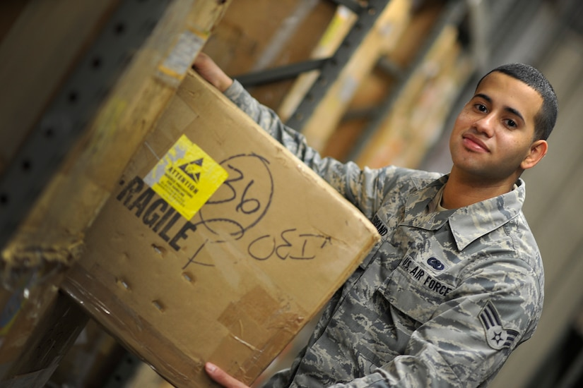 Senior Airman Christopher Ferrand, a material management technician with the 628th Logistics Readiness Squadron, retrieves a fuel quantity computer from supply to fulfill a customer's needs during night shift at Joint Base Charleston, S.C., Feb. 9, 2015. Ferrand is also a local rapper who performs at events and is recording his own album. (U.S. Air Force photo/Tech. Sgt. Renae Pittman)