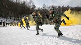 Republic of Korea Marines demonstrate their combat tactics for U.S. Marines during Korean Marine Exchange Program 15-4 Feb. 4 at the Pyeongchang Winter Training Facility, Pyeongchang, Republic of Korea. Sharing cultures is a significant factor in gaining a better understanding of the combat tactics of the two forces despite the language barrier, according to ROK Marine Capt. Moon Jung Hwan. KMEP is a regularly scheduled, bilateral, small-unit training exercise, which enhances the combat readiness and interoperability of ROK and U.S. Marine Corps' forces. The ROK Marines are with 1st Reconnaissance Battalion, 1st ROK Marine Division. The U.S. Marines are with Company L, 3rd Battalion, 3rd Marine Regiment, currently assigned to 4th Marine Regiment, 3rd Marine Division, III Marine Expeditionary Force under the unit deployment program. (U.S. Marine Corps photo by Pfc. Cedric R. Haller II/Released)