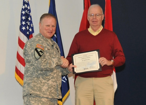 During the Jan. 23 Town Hall, Huntsville Center Commander Col. Robert J. Ruch presents Mark Batchelor with a Certificate of Achievement on behalf of Brig. Gen. Jeffrey Clark, Director of the Walter Reed National Military Medical Center.