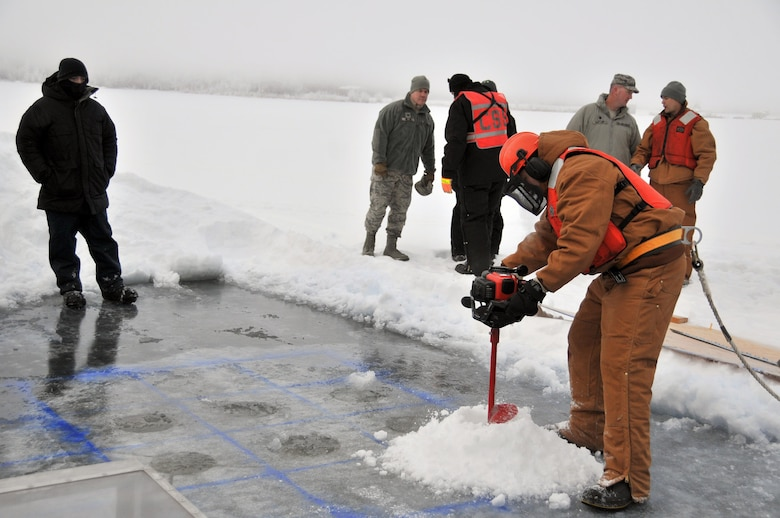 Tech. Sgt. Douglas Ward drills holes for blocks to be cut and removed during an Arctic oil spill response exercise Feb. 4, 2015, in Alaska. The removed blocks will open up a trench to deploy accumulation equipment to clean up a simulated spill. Members of the Alaska Department of Environmental Conservation, 611th Civil Engineer Squadron, U.S. Navy Supervisor of Salvage and Diving, and U.S. Coast Guardsmen participated in the exercise to learn Arctic spill response tactics and techniques. Ward is the 611th CES Heating, Ventilation, and Air Conditioning Shop NCO in charge (U.S. Air Force photo/Tech. Sgt. John Gordinier)