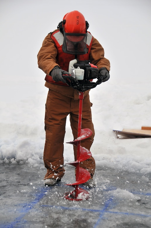 Senior Master Sgt. Gene Geren drills holes for blocks to be cut and removed during an Arctic oil spill response exercise Feb. 4, 2015, in Alaska. The removed blocks will open up a trench to deploy accumulation equipment to clean up a simulated spill. Members of the Alaska Department of Environmental Conservation, 611th Civil Engineer Squadron, U.S. Navy Supervisor of Salvage and Diving, and U.S. Coast Guardsmen participated in the exercise to learn Arctic spill response tactics and techniques. Geren is the 11th Air Force first sergeant. (U.S. Air Force photo/Tech. Sgt. John Gordinier)
