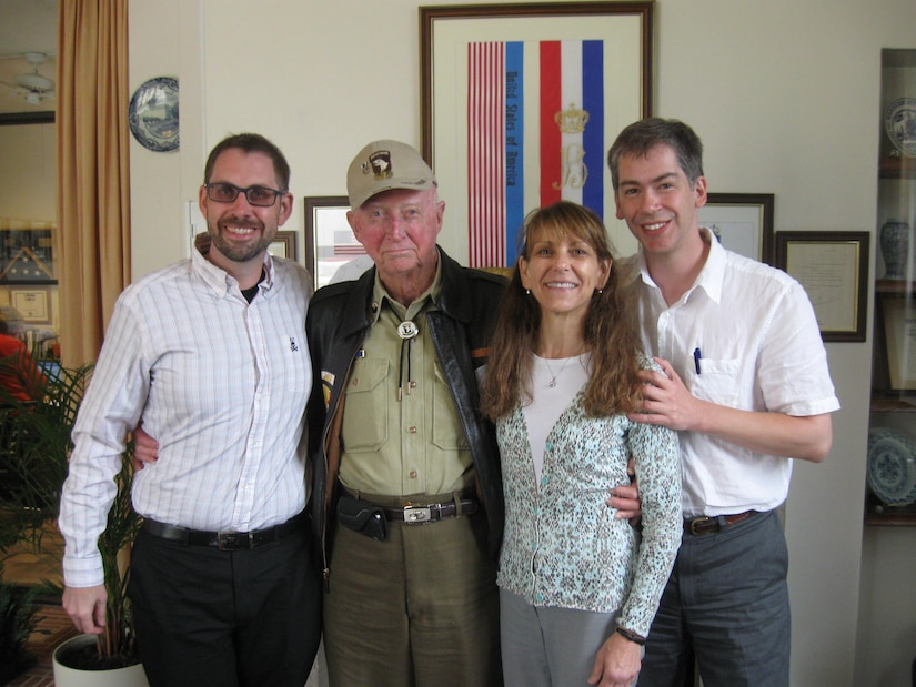 Dr. Jeffrey Johnson, Defense POW/MIA Accounting Agency (DPAA) historian, Pfc. Eugene E. Gilbreath, Ms. Christine Cohn, DPAA historian, and Dr. Edward Burton DPAA historian, (from left to right) pose for a photo after interviewing Gilbreath at the Netherlands American Cemetery, Margraten, Netherlands Sept. 22, 2014. Gilbreath was previously assigned to the Headquarters Company, 506th Parachute Infantry Regiment, 101st Airborne Division, during World War II.  DPAA conducts interviews with veterans of past conflicts dating back to World War II, to help locate missing Americans from past wars.