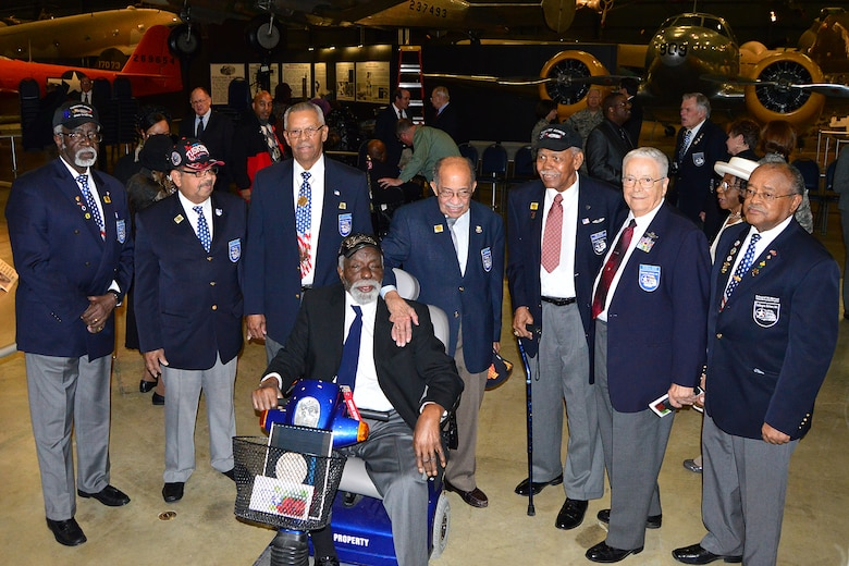 DAYTON, Ohio -- Tuskegee Airmen and Honorary Tuskegee Airmen gathered for photographs at the  expanded Tuskegee Airmen exhibit opening in the WWII Gallery at the National Museum of the U.S. Air Force on Feb. 10, 2015. (U.S. Air Force photo)