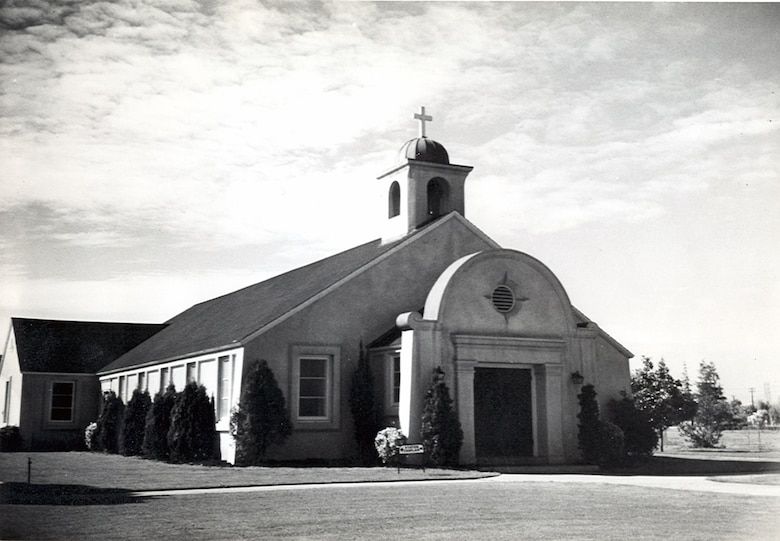 Black-and-white photograph of the Moffett Field Chapel. The chapel was constructed in 1945 and was modeled after the California Missions. The chapel owns a revolving altar which can be rotated to provide the appropriate settings for Protestant, Catholic, Jewish or non-denomination services. The chapel seats 200 people.  (Courtesy photo by the Sunnyvale Historical Society and Museum Association)