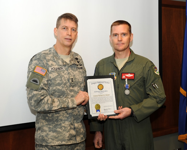 Col. Richard Wedan, 142nd Fighter Wing commander is award the Oregon National Guard Exceptional Service Medal by Maj. Gen. Daniel R. Hokanson, The Adjutant General, Oregon, during a ceremony at the Portland Air National Guard Base, Ore., Jan. 7, 2014. (U.S. Air National Guard photo by Master Sgt. Shelly Davison/Released)