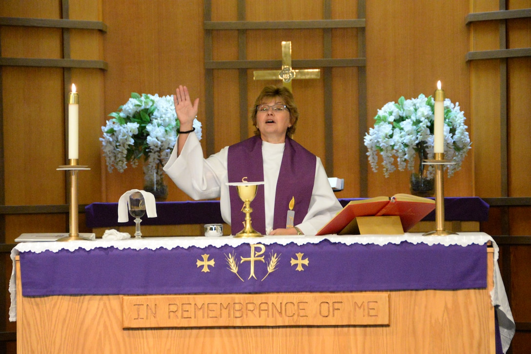 Chaplain (Lt. Col.) Laura Adelia, assigned with the 129th Rescue Wing, leads a worship services at the historic Moffett Chapel, Moffett Federal Airfield, Calif. After two and half years the chapel reopened on Sunday, Dec. 7, 2014, Pearl Harbor Remembrance Day. Through the combined efforts of the Parks Reserve Forces Training Area and the 129th Rescue Wing, resources were found to reopen the chapel to all military, dependents, retires and the local community for religious services. (U.S. California Air National Guard photo by Tech. Sgt. Ray Aquino/Released)