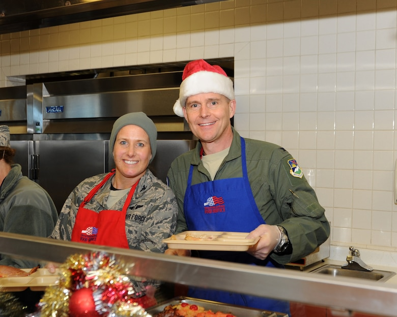 Col. Richard Wedan, 142nd Fighter Wing Commander and Col. Heidi Kjos, 142nd Fighter Wing Medical Group Commander serve holiday lunch to members of the wing, Dec. 07, 2013 at the Portland Air National Guard Base, Ore. (U.S. Air National Guard photo by Master Sgt. Shelly Davison/Released)