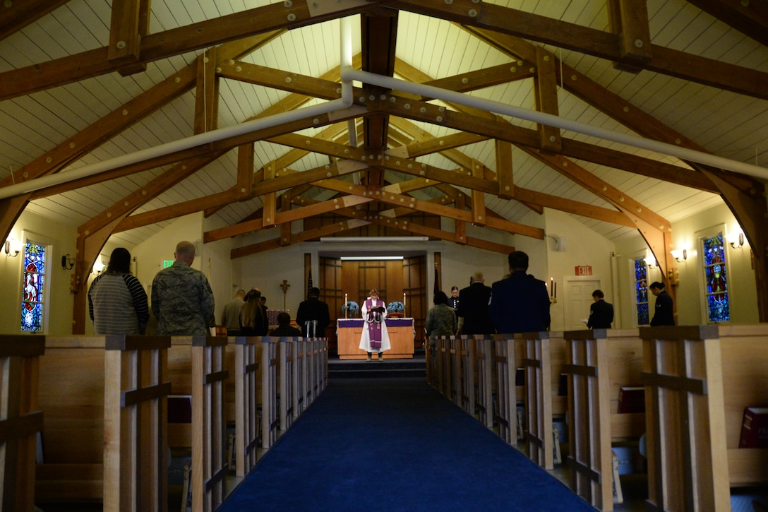 California Air National Guardsmen with the 129th Rescue Wing chaplain's office provide worship services during the grand re-opening of Moffett Chapel at Moffett Federal Airfield, Calif., Dec. 7, 2014.  The Moffett Chapel has been closed for two and a half years.  (U.S. California Air National Guard photo by Tech. Sgt. Ray Aquino/Released)