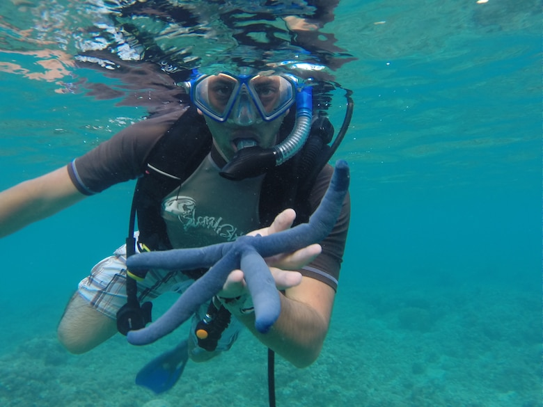 U.S. Air National Guard Staff Sgt. Xavier Martinez-Soto from the 146th Airlift Wing Civil Engineering Squadron snorkels with local underwater sea creatures at Gab Gab Beach in Guam on February 1, 2015. (U.S. Air National Guard photo by Staff Sgt. Sonny DaSilva/Released)
