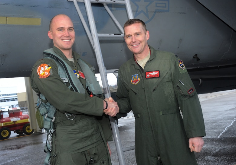 Air National Guard Col. Richard W. Wedan, right, exchanges a word with his son, Air Force 2nd Lt. Steven Wedan, after they flew in formation together Feb. 7, 2015, at Portland Air National Guard Base, Ore. The flight was Col. Wedan's last in an F-15 Eagle and as commander of the 142nd Fighter Wing. Lt. Wedan flew in the backseat of Col. Wedan's wingman jet, piloted by Col. Paul T. Fitzgerald, 142nd Fighter Wing Vice Commander. Col. Fitzgerald assumed command of the wing during a ceremony held here Feb. 7. Lt. Wedan is scheduled to graduate from Air Force pilot training next week. (U.S. Air National Guard photo by Tech. Sgt. John Hughel, 142nd Fighter Wing Public Affairs/Released)