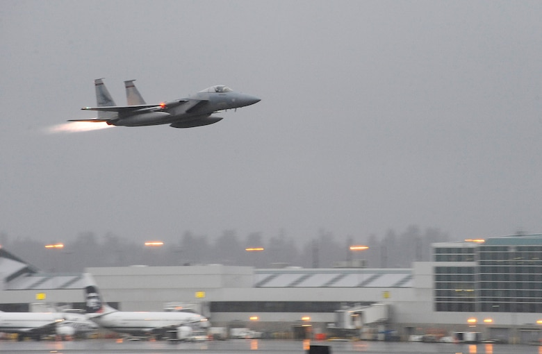Col. Richard W. Wedan, 142nd Fighter Wing commander, takes off on his 'Fini Flight' from the Portland Air National Guard Base, Ore., in his F-15 Eagle, Feb. 7, 2015. (U.S. Air National Guard photo by Tech. Sgt. John Hughel, 142nd Fighter Wing Public Affairs/Released)