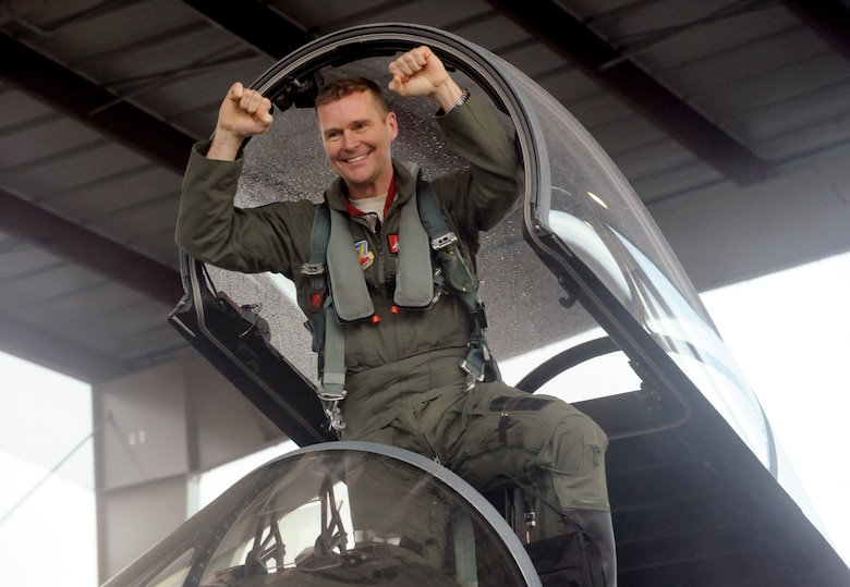 Col. Richard W. Wedan, 142nd Fighter Wing commander, celebrates after his last flight in an F-15 Eagle pilot with in the Air National Guard. Col. Wedan retired from military service later in the day during a formal ceremony held here. (U.S. Air National Guard photo by Tech. Sgt. John Hughel, 142nd Fighter Wing Public Affairs/Released)