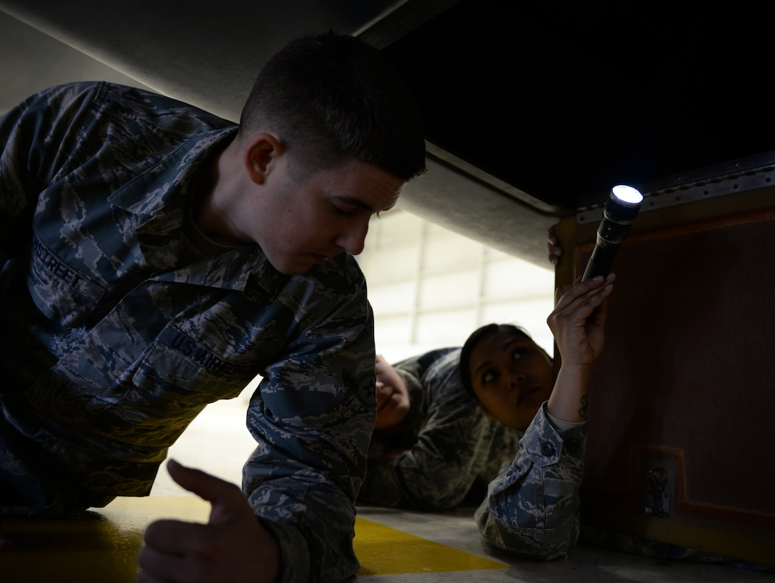 Tech. Sgt. Maureen Madamba (right), 372nd Training Squadron Detachment 21 maintenance instructor, inspects the interior of a RQ-4 Global Hawk with Airman Murray Hemstreet , 372nd TRS Detachment 21, student, Jan. 20, 2015, at Beale Air Force Base, Calif. Hemstreet is one of the first students to attend the  RQ-4 remotely piloted aircraft maintenance course taught at Beale. (U.S. Air Force photo by Senior Airman Bobby Cummings/Released)