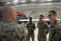 Airmen with the 372nd Training Squadron Detachment 21 receive guidance from Tech. Sgt. Randy Thornsberry Jr., 372nd TRS Detachment 21 maintenance instructor, during a maintenance inspection of an RQ-4 Global Hawk Jan. 20, 2015, at Beale Air Force Base, Calif. The Airmen are the first students to attend the RQ-4 remotely piloted aircraft maintenance course taught at Beale. (U.S. Air Force photo by Senior Airman Bobby Cummings/Released)