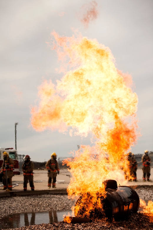 GOODFELLOW AIR FORCE BASE, Texas – A simulation fire burns as students of the 312th Training Squadron prepare to extinguish it, at the Louis F. Garland Department of Defense Fire Fighting Academy, Feb. 3. This is just one of the many static exercises the students engage in for putting out fires. (U.S. Air Force photo/ Senior Airman Scott Jackson)