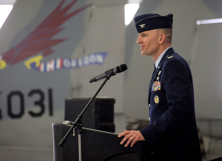 U.S. Air Force Col. Paul T. Fitzgerald, incoming commander 142nd Fighter Wing, gives his inaugural speech as  the new commander of the 142nd Fighter Wing during the Change of Command ceremony held Feb. 7, 2015, Portland Air National Guard Base, Ore. (U.S. Air National Guard photo by Tech Sgt. John Hughel, 142nd Fighter Wing Public Affairs)
