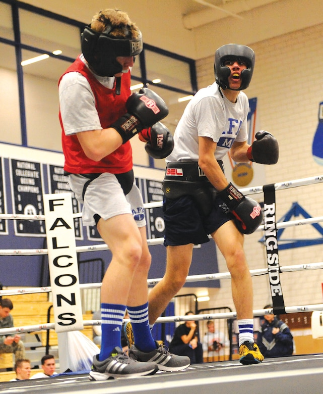 Cadets Tim Smith (left) and John Fredericks battle each other in the ring Jan. 15. (U.S. Air Force photo/ John Van Winkle)