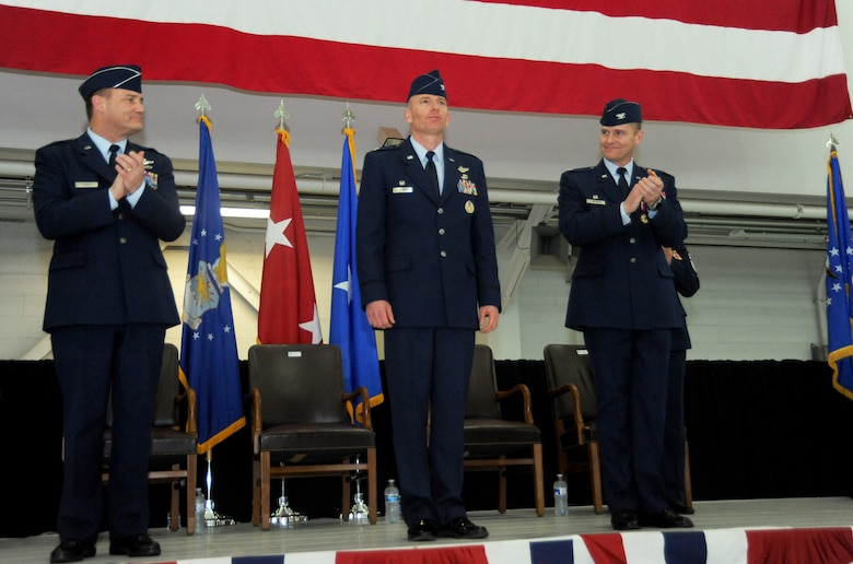 Commander of the Oregon Air National, U.S. Air Force Brig. Gen. Michael E. Stencel, left, and U.S. Air Force Col. Richard W. Wedan, outgoing commander 142nd Fighter Wing, right, applaud U.S. Air Force Col. Paul T. Fitzgerald, center, after formally taking command of the 142nd Fighter Wing during the Change of Command ceremony held Feb. 7, 2015, Portland Air National Guard Base, Ore. Fitzgerald is a command pilot with over 2,200 flight hours in the F-15 Eagle. (U.S. Air National Guard photo by Tech. Sgt. John Hughel, 142nd Fighter Wing Public Affairs)