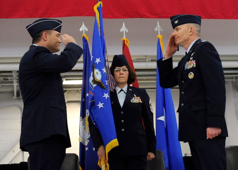 U.S. Air Force Paul T. Fitzgerald, incoming commander 142nd Fighter Wing, right, renders his first salute at the new 142nd Fighter Wing commander from Brig. Gen. Michael E. Stencel, commander Oregon Air National Guard, left, during the Change of Command ceremony held Feb. 7, 2015, Portland Air National Guard Base, Ore. Fitzgerald is a command pilot with over 2,200 flight hours in the F-15 Eagle. (U.S. Air National Guard photo by Tech. Sgt. John Hughel, 142nd Fighter Wing Public Affairs)