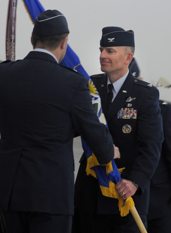 U.S. Air Force Paul T. Fitzgerald, incoming commander 142nd Fighter Wing, right, receives the guide on colors from Brig. Gen. Michael E. Stencel, commander Oregon Air National Guard, left, during the Change of Command ceremony held Feb. 7, 2015, Portland Air National Guard Base, Ore. Fitzgerald is a command pilot with over 2,200 flight hours in the F-15 Eagle. (U.S. Air National Guard photo by Staff Sgt. Brandon Boyd, 142nd Fighter Wing Public Affairs)