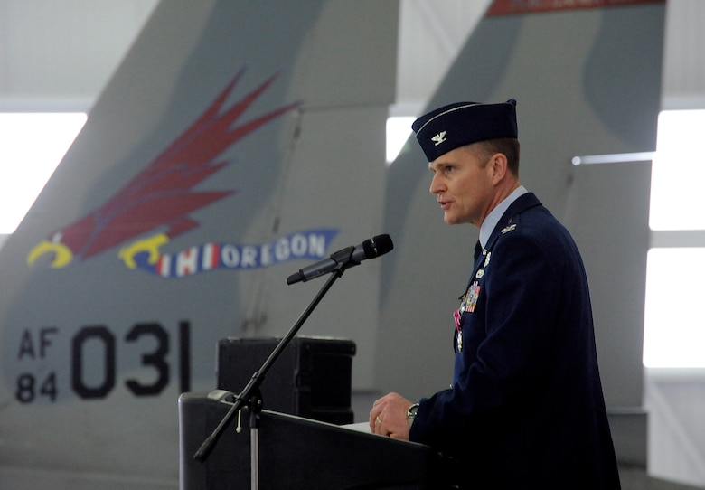 U.S. Air Force Col. Richard W. Wedan, outgoing commander 142nd Fighter Wing, Oregon Air National Guard, gives his farewell remarks as commander of the 142nd Fighter Wing to those attending the Change of Command ceremony for the wing, held at the Portland Air National Guard Base, Ore. Feb. 7, 2015. (U.S. Air National Guard photo by Tech. Sgt. John Hughel, 142nd Fighter Wing Public Affairs)